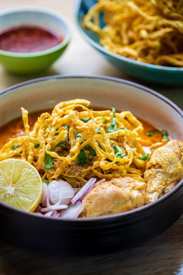 Khao Soi Kai, Northern Thai Noodle Curry Soup with Chicken. Close up of Khao Soi Kai, Northern Thai Noodle Curry Soup with Chicken royalty free stock image