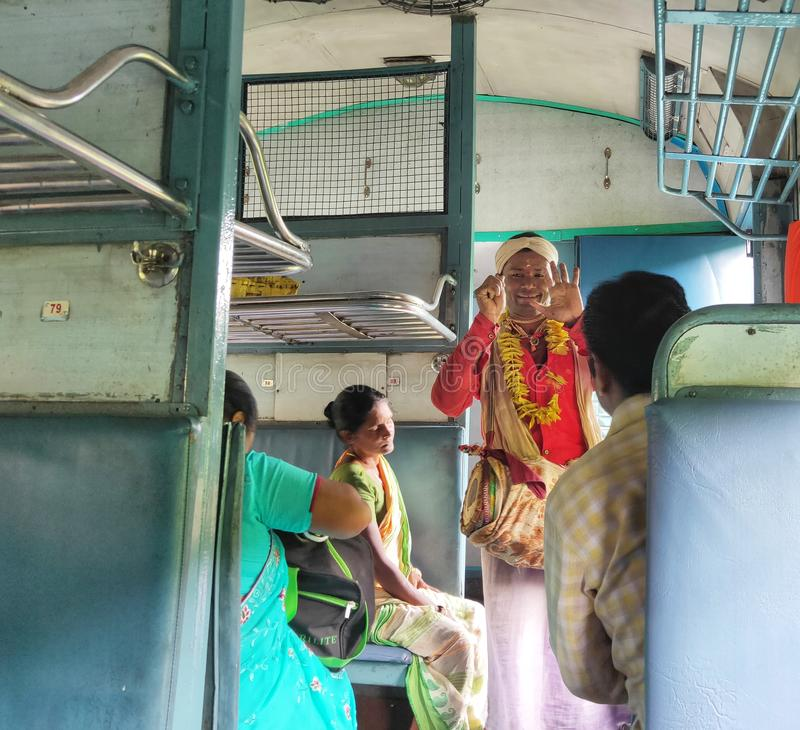 Indian folk singer performs in a local train. Kharagpur, West bengal, India- August 23, 2019: Indian folk singer performs in a local train, music, person, man stock photography