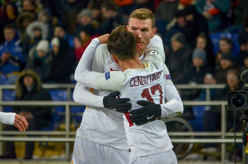 KHARKIV, UKRAINE - FEBRUARY 21, 2018: AS Roma players and Cengiz Under celebrates the goal scored during UEFA Champions League ma stock photos