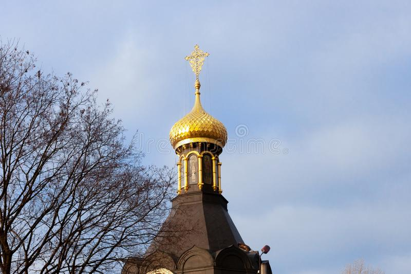 Orthodox church with a golden shining dome in the city of Kharkiv stock image