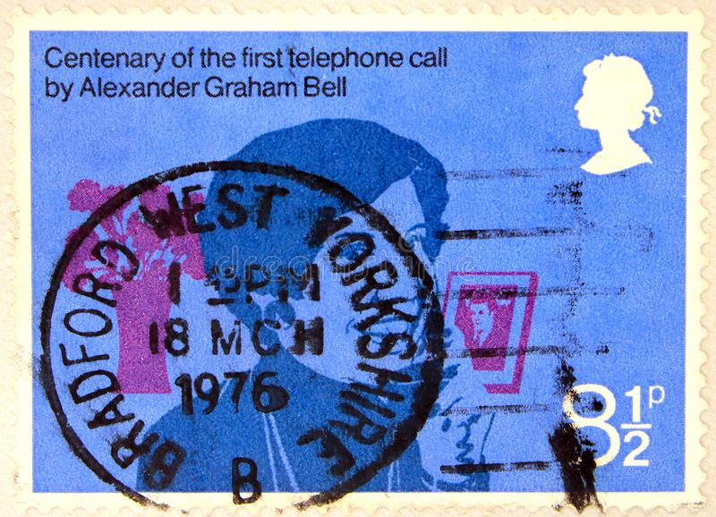 A stamp of United Kingdom dedicated to the first telephone call royalty free stock photos