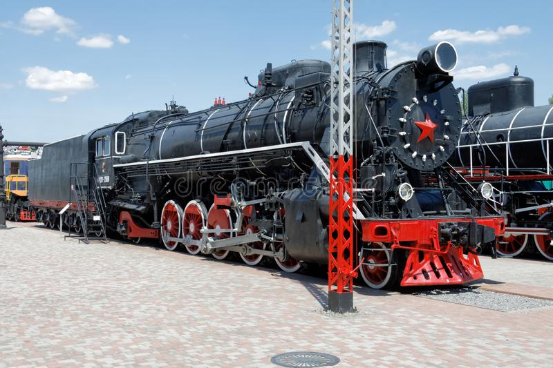 Old black steam locomotive in museum stock photo