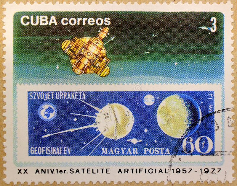 Postal stamp of Cuba, dedicated to the 20th anniversary of the first artificial satellite stock photography