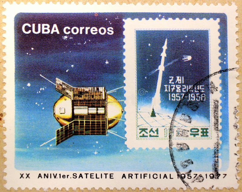 Postal stamp of Cuba, dedicated to the 20th anniversary of the first artificial satellite stock photos