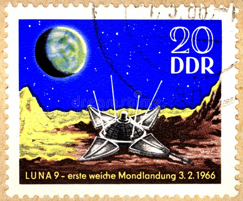 Postal stamp of GDRshows the Soviet Luna 9 mission royalty free stock images