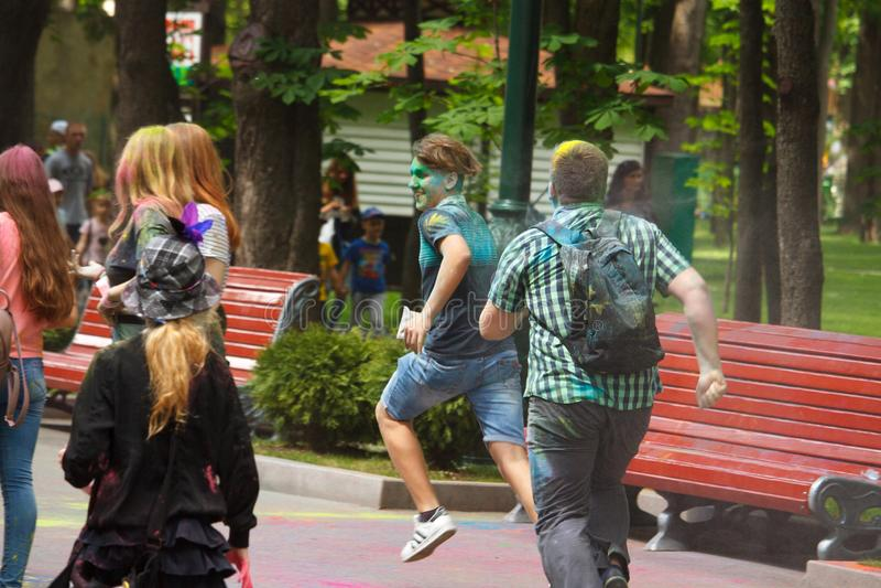 KHARKIV, UKRAINE - MAY 19, 2018: happy people celebrate Holi color festival royalty free stock photo