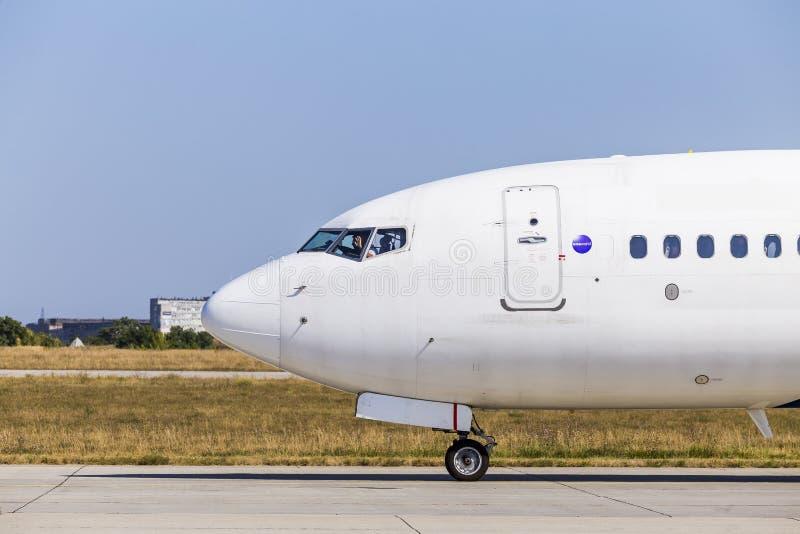 Kharkov/Ukraine - August 19, 2018: Airbus A319 of FANair in Kharkov Airport, baggage luggage loading. Kharkov/Ukraine - August 19, 2018: Nose of Airbus A319 stock images