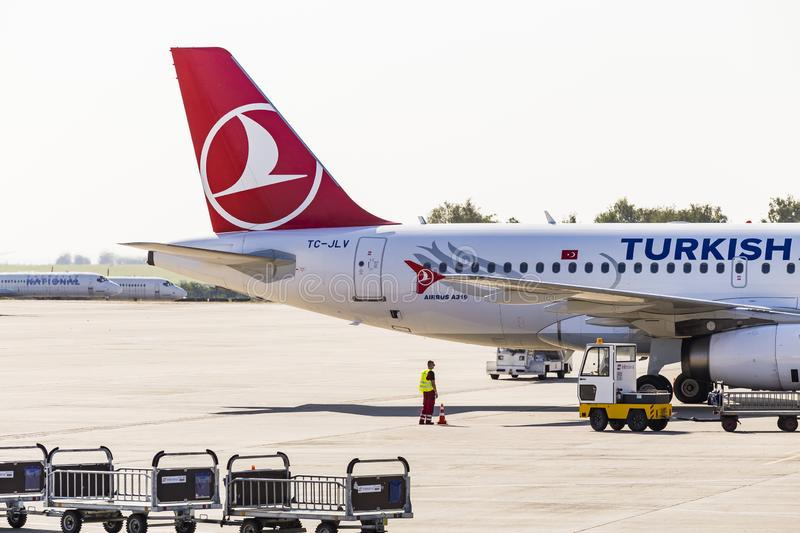 Kharkov/Ukraine - August 19, 2018: Airbus A319 of Turkish Airlines in Kharkov Airport, baggage luggage loading.  stock photography