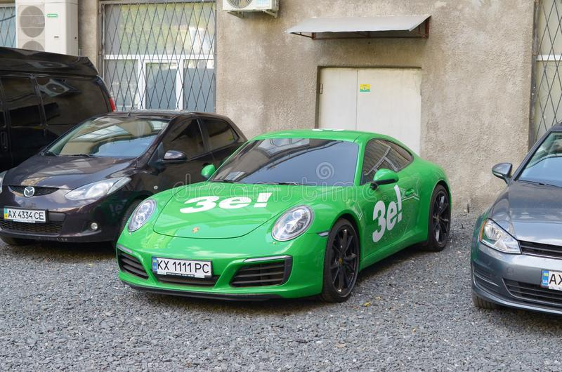 Porsche 911 Carrera 4S in green color with white stickers of Ze Team royalty free stock image