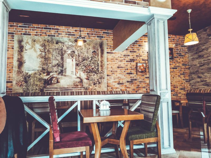 KHERSON, UKRAINE - APRIL 12, 2019: Inside interior in small modern pub cafe with loft design style royalty free stock images
