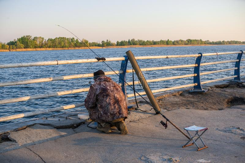 Fishermen on the waterfront in Kherson, Ukraine. Kherson, Ukraine - 04.27.2019. Fishermen on the embankment alley in Kherson, Ukraine, on a spring evening royalty free stock photography