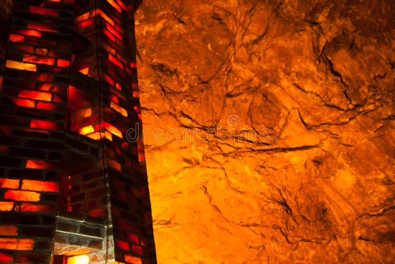 Khewra salt mine interior. Islamic, sacred, names, pink, salt, glowig, lamp, glowing, bricks, background, interior, mine, tower, made, tiles, khewra, saltmines royalty free stock image