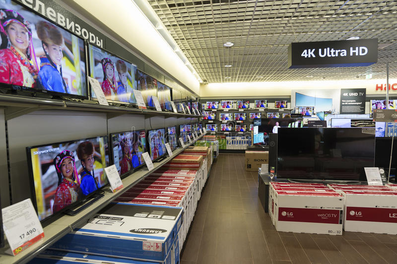Khimki, Russia - December 22 2015. TV in Mvideo large chain stores selling electronics and household appliances. Khimki, Russia - December 22 2015. TV in Mvideo stock photos