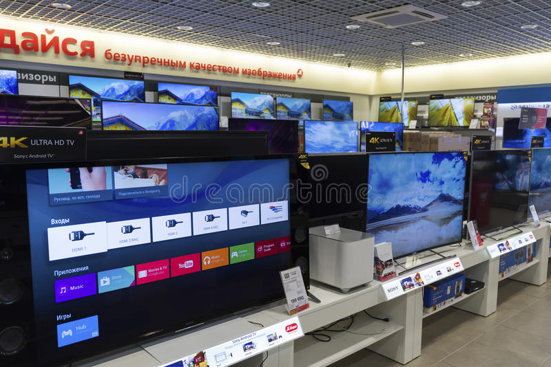 Khimki, Russia - December 22 2015. TV in Mvideo large chain stores selling electronics and household appliances. Khimki, Russia - December 22 2015. TV in Mvideo stock photo