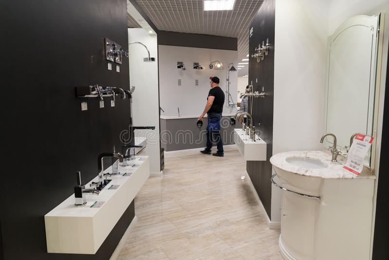 Khimki, Russia - September 03.2016. selling water faucet and sanitary ware in largest furniture store Grand. Khimki, Russia - September 03.2016. selling baths stock photo