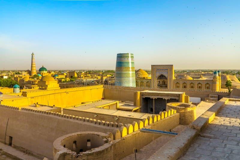 Khiva Old City 101. Khiva Old Town Kunya Ark Citadel Cityscape Viewpoint of Ak Sheikh Bobo Kalta Minor Minaret and Mohammed Amin Khan Madrasa Sunset stock photos