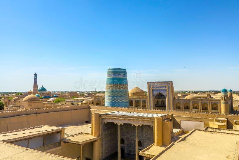 Khiva Old City 41. Khiva Old Town Kunya Ark Citadel Cityscape Viewpoint of Ak Sheikh Bobo Kalta Minor Minaret and Mohammed Amin Khan Madrasa stock photos