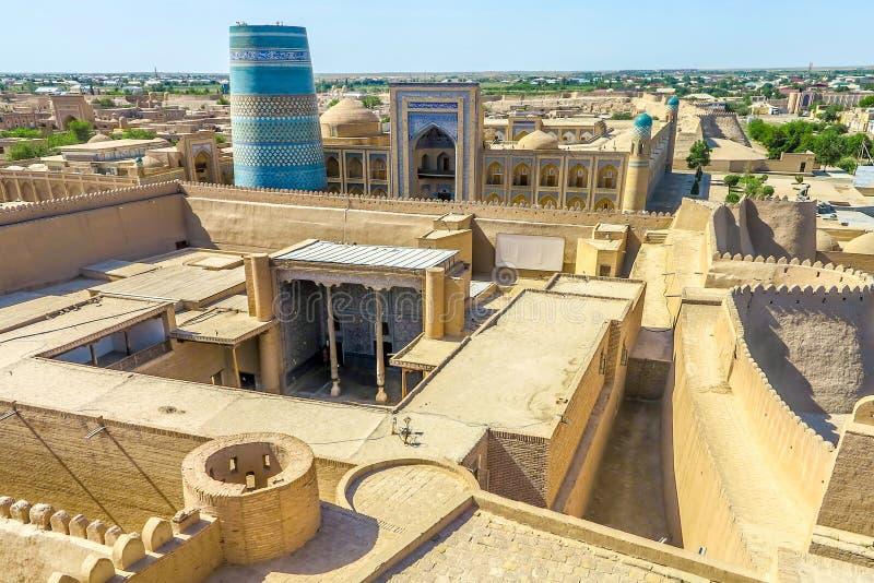 Khiva Old City 43. Khiva Old Town Kunya Ark Citadel Cityscape Viewpoint of Ak Sheikh Bobo Kalta Minor Minaret and Mohammed Amin Khan Madrasa stock photography