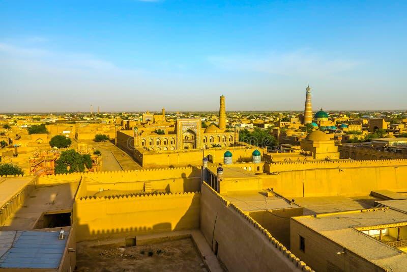 Khiva Old City 99. Khiva Old Town Kunya Ark Citadel Cityscape Viewpoint of Pahlavon Mahmoud Complex Juma Mosque Minaret at Sunset stock images