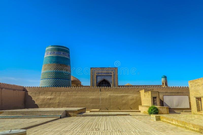 Khiva Old City 37. Khiva Old Town Kunya Ark Citadel View of Kalta Minor Minaret and Mohammed Amin Khan Madrasa Iwan stock photos