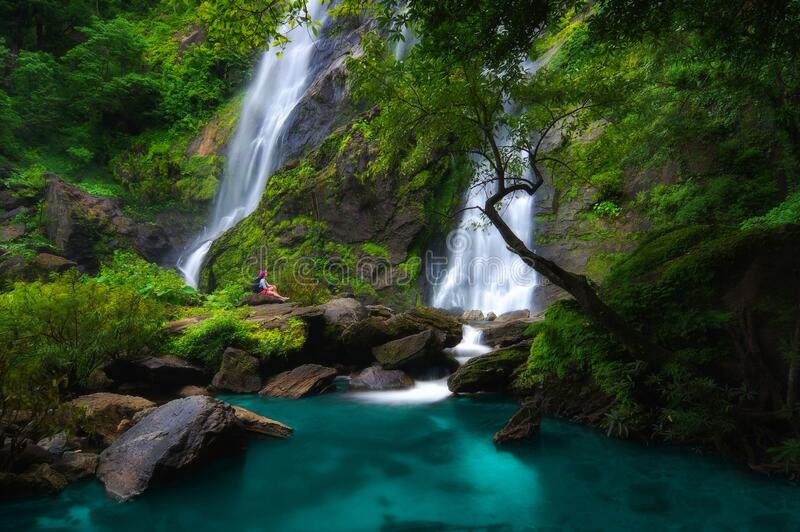 Khlong Lan Waterfall. Backpacker sit in waterfall, Khlong Lan Waterfall was the last major waterfall Khlong Lan National Park, Kamphaeng Phet Thailand royalty free stock photos