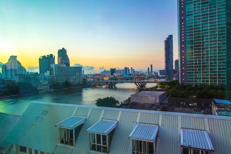 Khlong San,Bang Rak,Sathorn,Bangkok,Thailand on February 19,2019:King Taksin BridgeSathorn Bridge and Bangkok skyline in early m royalty free stock image