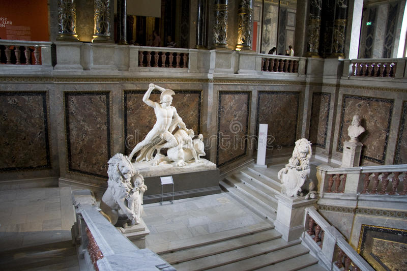 KHM stairway. Stairway of a Kunst-Historisches Museum in Vienna with antique decoration and sculptures KHM is a major European cultural institution with royalty free stock photo