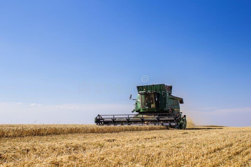 Khmelnitskiy, Ukraine - July 23: Modern John Deere combine harve. Sting grain in the field near the town Khmelnitskiy, Western Ukraine July 23, 2015 stock photography
