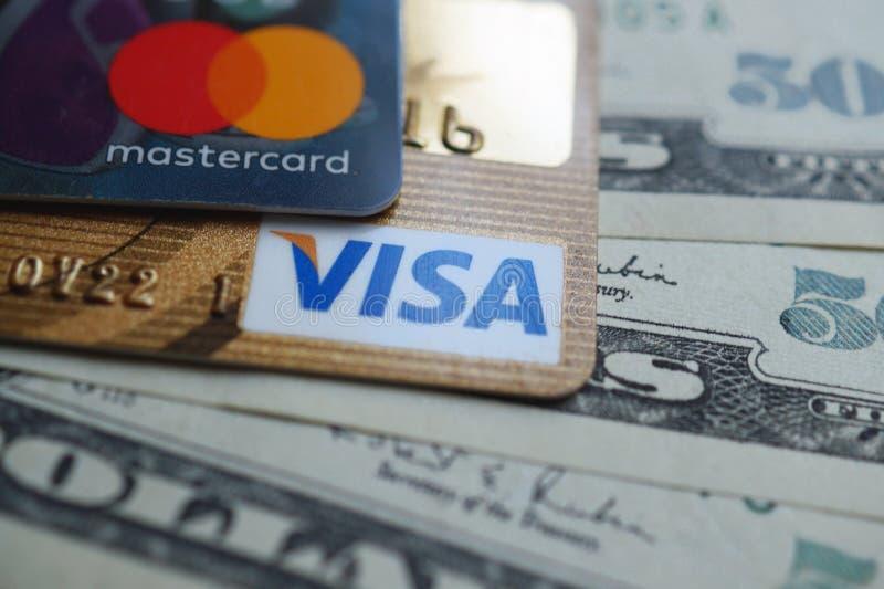 VISA and Mastercard credit card with american dollars stock photos