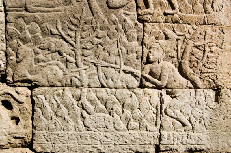 Khmer Antiguo Que Talla Al Cazador De Los Ciervos Imagen de archivo libre de regalías