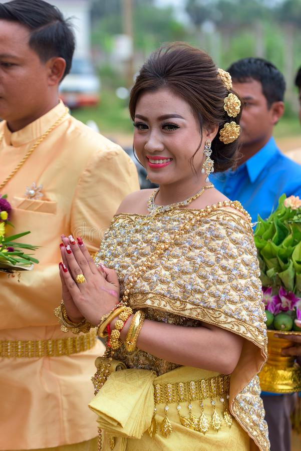 Khmer bride standing with her future husband wearing traditional Khmer outfit stock images