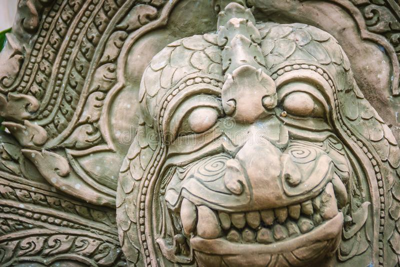 Khmer` s style Naga head made from sand stone at the public temple in Thailand. Naga or large snake according to Hindu belief. Khmer` s style Naga head made royalty free stock photography