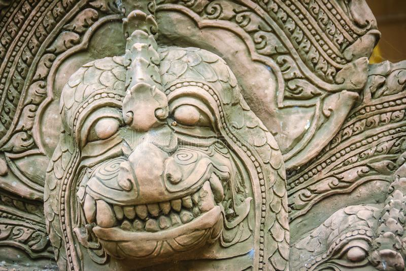 Khmer` s style Naga head made from sand stone at the public temple in Thailand. Naga or large snake according to Hindu belief. Khmer` s style Naga head made royalty free stock images