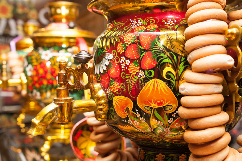 Khokhloma painted traditional Russian samovar with bunch of bagels stock photography