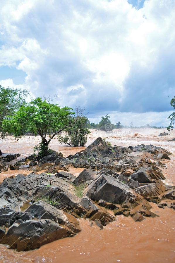 Khone Phapheng falls on the Mekong River in Laos during the Monsoon flooding.  royalty free stock photo