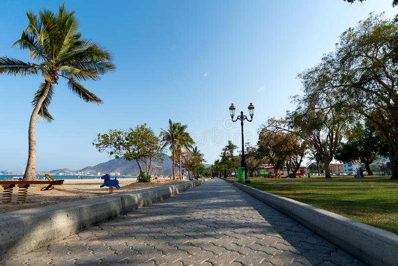 Khor Fakkan, United Arab Emirates - March 16, 2019: Khor Fakkan public beach in the emirate of Sharjah in United Arab Emirates. On a sunny day uae sky gulf stock images