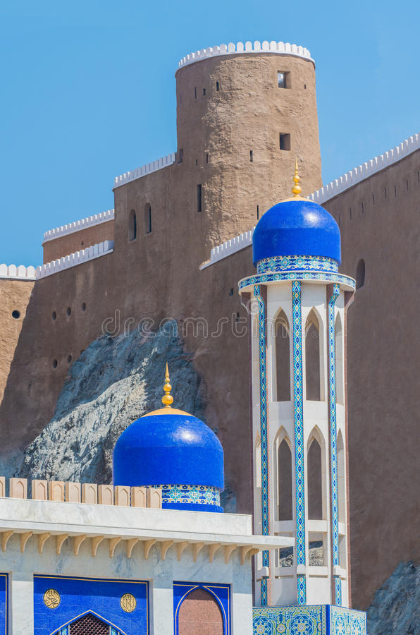 The Khor mosque and Fort Marani, Muscat, Oman. The Khor mosque and Fort Marani near Sultan Qabos` palace in the old city of Muscat, Sultanate of Oman royalty free stock image