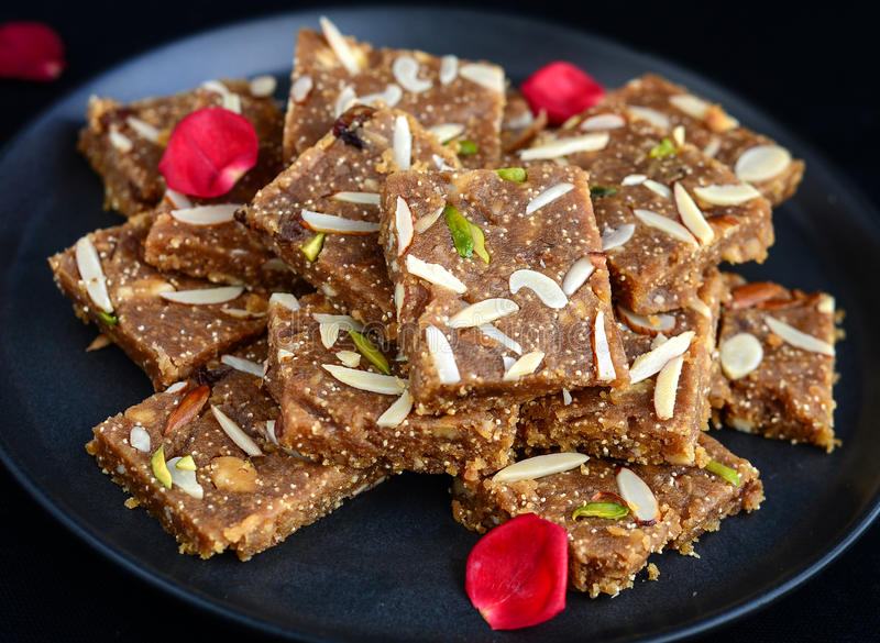 Khorak. Sindhi sweet prepared with nuts,flour,poppy seeds,ghee or clarified butter eaten during Diwali stock images