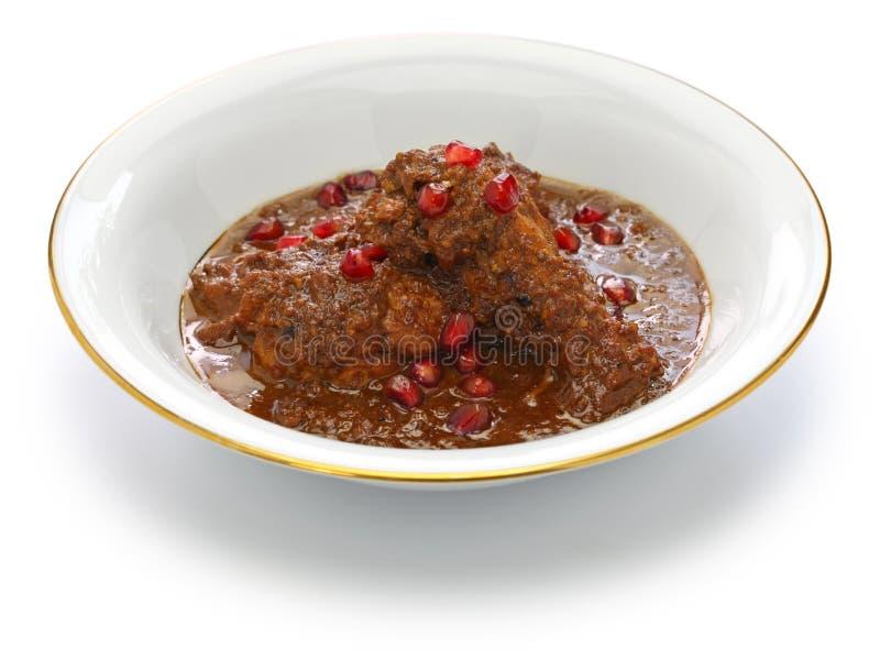 Chicken fesenjan, pomegranate walnut stew, iranian persian cuisine. Khoresht fesenjan ba morgh, chicken stew with pomegranate & walnut, iranian persian cuisine stock image
