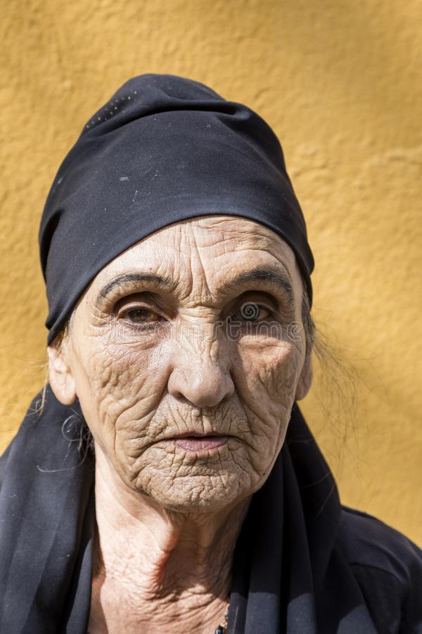 Khorog, Tajikistan August 25 2018: Beautiful old Tajik woman with headscarf and deep facial wrinkles in Khorog, Tajikistan stock photos