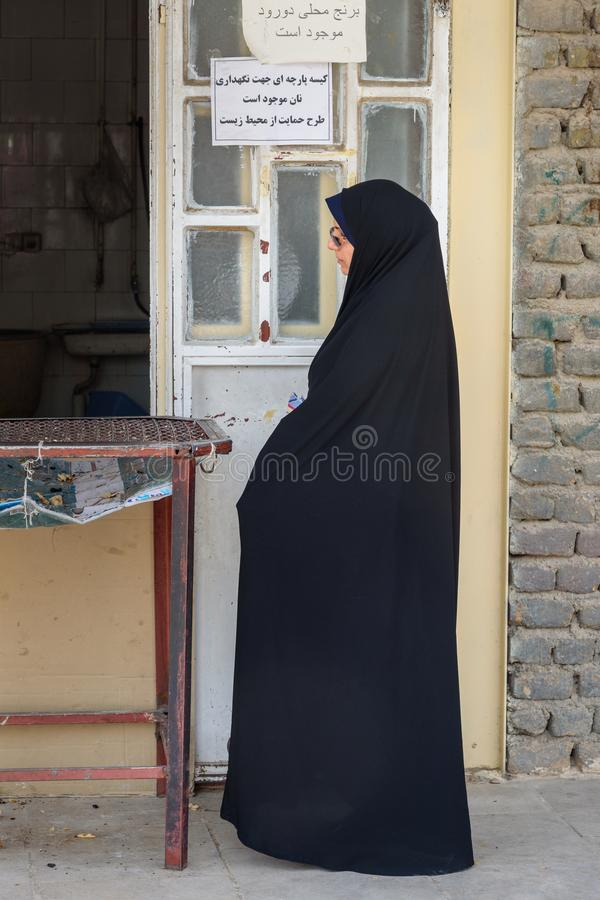 Iranian woman buying bread in shop on the street in Khorramabad. Iran stock photography