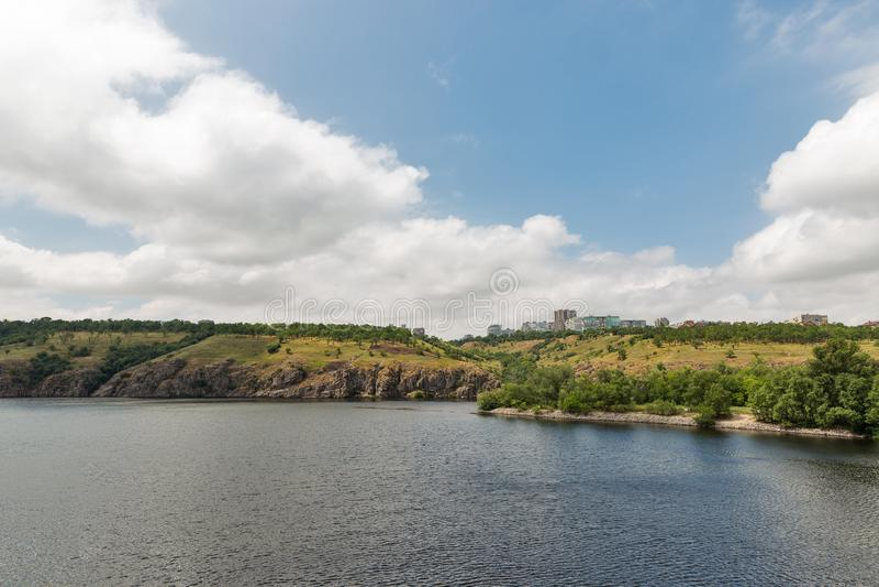 Khortytsia island, Zaporizhia cityscape and River Dnieper, Ukraine. Landscape with Zaporizhia cityscape in the distance and Khortytsia, the largest island in the royalty free stock photos