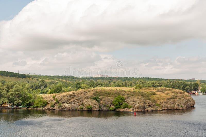 Khortytsia island, Zaporizhia cityscape and River Dnieper, Ukraine. Landscape with Zaporizhia cityscape in the distance and Khortytsia, the largest island in the stock images