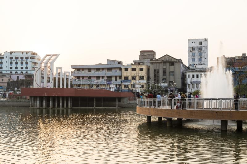 Khulna, Bangladesh, February 28 2017: City center with park. And pond in Khulna in the evening light stock photos