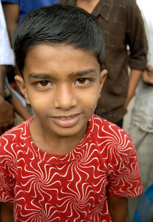 Khulna, Bangladesh:  Portrait of a young boy in Khulna. Local life in Khulna, Bangladesh royalty free stock photo