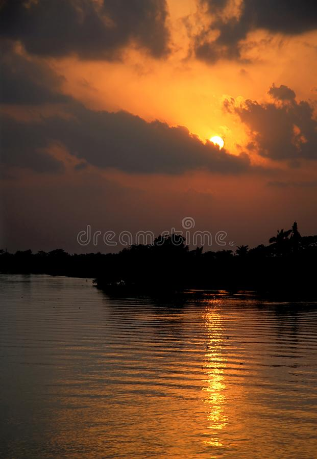Khulna, Bangladesh: Sunset on the Rupsa River near Khulna. Khulna, Bangladesh: Sunset on the Rupsa River or Rupsha River or near Khulna, Bangladesh. Taken on the stock image