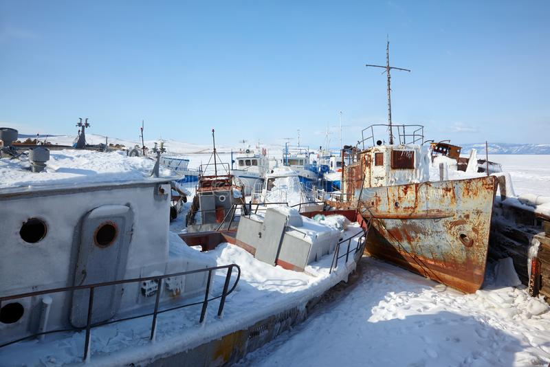 Old frozen ships in the port of Olkhon island on siberian lake Baikal royalty free stock images