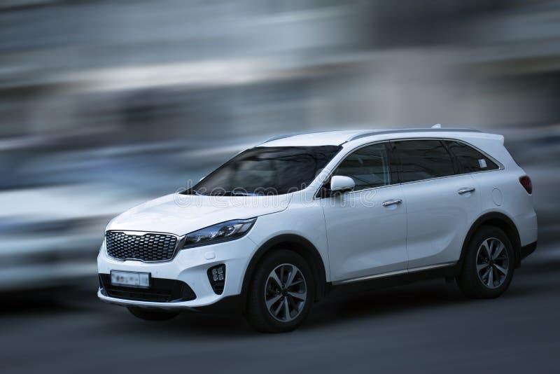 Kia white car. Kia white car on motion blurred background stock photos