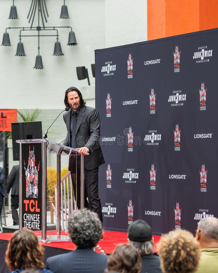 Keanu Reeves. Actor`s Handprints and Footprints Cemented on Hollywood Boulevard. Chinese Theater Event, Guests, Celebrities, Halle Berry, Laurence Fishburne royalty free stock image