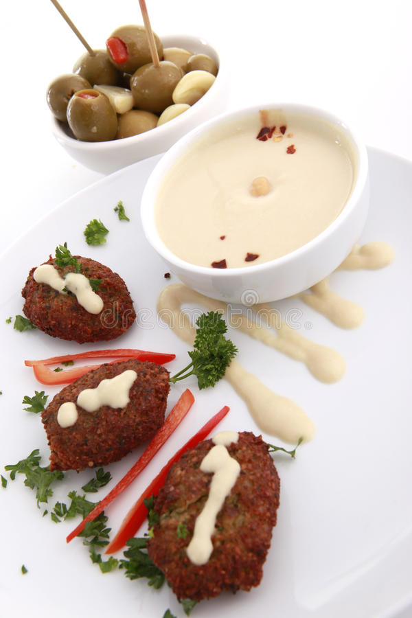 Kibbe and hummus tahine royalty free stock photography
